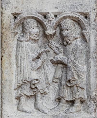 Formella a rilievo con Anselmo che riceve le terre da Astolfo.