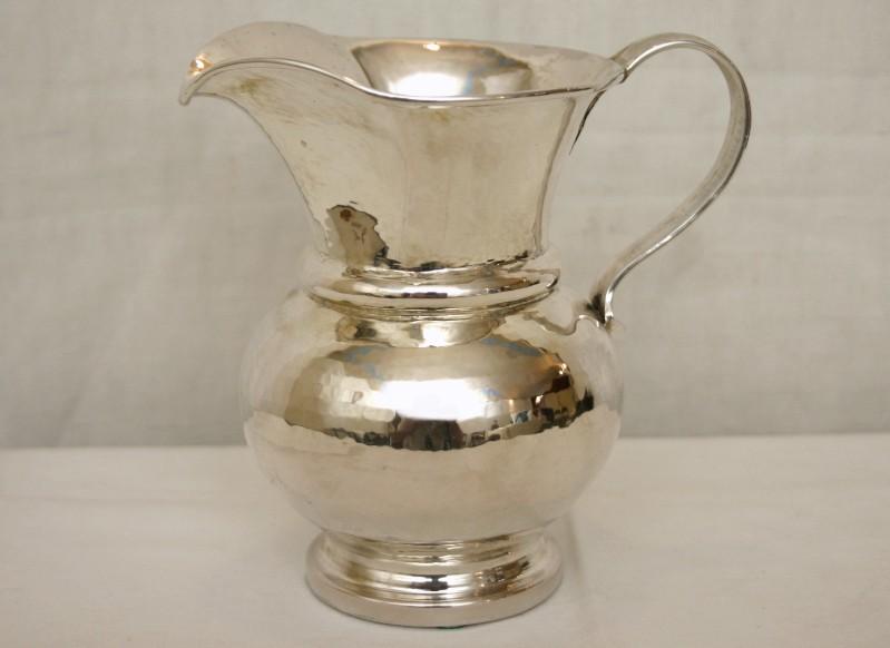 Bott. italiana sec. XX, Brocca in argento
