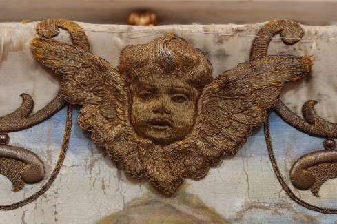 Manif. romagnola sec. XVIII, Ricamo imbottito con cherubino