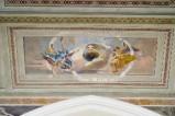Melle G. (1949), Dipinto murale di angeli reggicartiglio